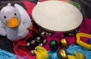 A toy duck and a tambourine