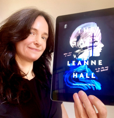 Jenny holds up a copy of The Gaps by Leanne Hall