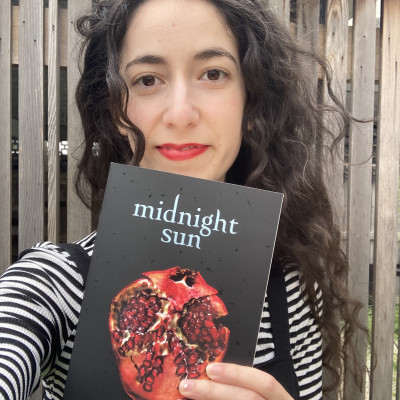 Emily holds a copy of Midnight Sun